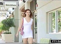 Teen hottie showing her bald pussy upskirt outdoor