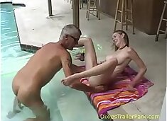 Naked dad and daughter take a swim